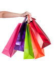 Woman Carrying Shopping Bags. Isolated in a white background Stock Photos