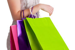 Woman Carrying Shopping Bags. Isolated in a white background Royalty Free Stock Photography