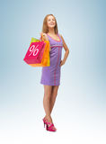 Woman carrying shopping bags Royalty Free Stock Photography