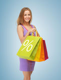 Woman carrying shopping bags Stock Image