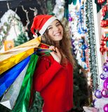 Woman Carrying Shopping Bags At Christmas Store Royalty Free Stock Images
