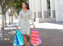 Woman Carrying Shopping Bags On City Street Royalty Free Stock Photos