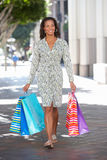 Woman Carrying Shopping Bags On City Street Royalty Free Stock Photography
