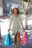 Woman Carrying Shopping Bags On City Street Royalty Free Stock Photo