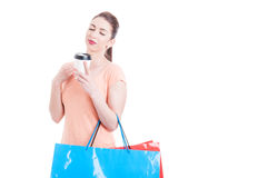 Woman carrying shopping bags enjoying cup of coffee concept Royalty Free Stock Photography