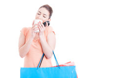 Woman carrying shopping bags enjoying smell of fresh coffee Royalty Free Stock Photo