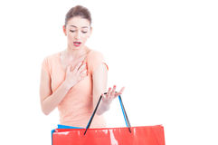 Woman carrying shopping bags feeling shocked or indignant Royalty Free Stock Image