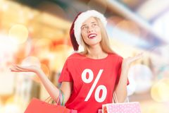 Woman carrying shopping bags Stock Photography