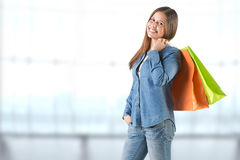Woman Carrying Shopping Bags. Isolated in white royalty free stock photo