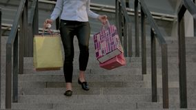 Woman carrying shopping bags. stock video footage