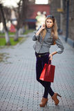 Woman carrying shopping bags outdoor Stock Photo