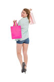 Woman carrying shopping bags over her shoulder Stock Image
