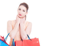 Woman carrying shopping bags posing camera looking Stock Photo