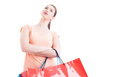 Woman carrying shopping bags posing low angle as hero shot Stock Photos
