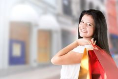 Woman Carrying Shopping Bags Royalty Free Stock Image