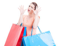 Woman carrying shopping feeling scared or afraid Stock Photo
