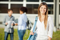 Woman Carrying Shoulder Bag With Students In Stock Photos