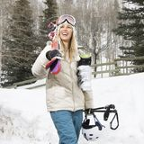 Woman carrying ski gear. Royalty Free Stock Photo