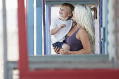 Woman Carrying Son At Porch Royalty Free Stock Photography