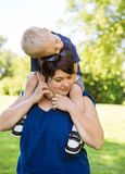 Woman Carrying Son On Shoulders In Park Royalty Free Stock Photo