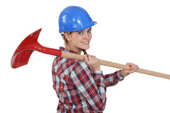 Woman carrying spade. Woman carrying a spadeover her shoulder Stock Photos