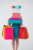 Woman carrying stack of gift boxes and shopping bags royalty free stock photo