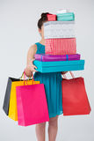 Woman carrying stack of gift boxes and shopping bags Stock Images