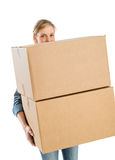 Woman Carrying Stacked Cardboard Boxes Royalty Free Stock Photos