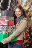 Woman Carrying Stacked Gift Boxes In Christmas Stock Images