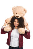 Woman is carrying a teddy bear on her shoulders Royalty Free Stock Image