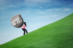 Woman carrying text of interest rates Stock Photo