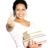 Woman carrying textbooks giving a thumbs up Royalty Free Stock Photos