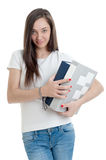 Woman carrying thick volumes Royalty Free Stock Images