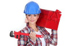 Woman carrying tool box Royalty Free Stock Images