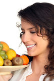 Woman carrying tray of fruits Royalty Free Stock Photo