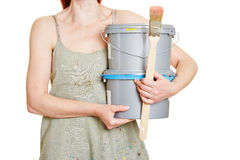 Woman carrying paint bucket Royalty Free Stock Photography