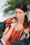 Woman carrying two travel bags Stock Photo
