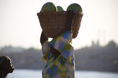Woman carrying vegetables in Mopti Stock Images