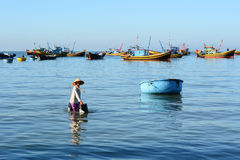 A woman carrying water at fishing village in Ninh Hoa, Vietnam Stock Photo