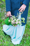 Woman carrying watering pot with blooming branches Stock Photography