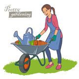 Woman carrying a wheelbarrow Royalty Free Stock Photography