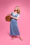 Woman carrying wicker basket Royalty Free Stock Photography