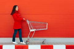 Woman with Cart Ready for Shopping Spree on Sale Season. Beautiful casual holiday season shopper girl going to the store Stock Photos