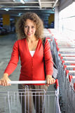 Woman with cart standing in indoor car park Stock Photos