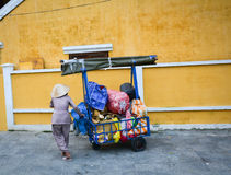 A woman with the cart on street in Hoi An, Vietnam Stock Photos