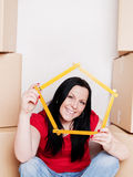 Woman with carton boxes holding measuring tape Royalty Free Stock Photo