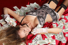 Woman with cash Stock Photography