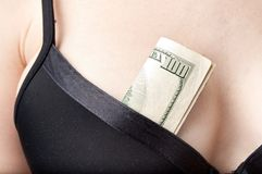Woman with cash in a bra Stock Photography