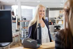 Woman At Cash Counter Royalty Free Stock Photo
