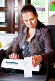 Woman and cash register Stock Photography